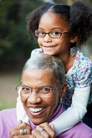 African American grandmother and granddaughter hugging