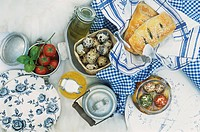 Tomatoes, milk jug, cheese balls, spinach pasties, quails´ eggs
