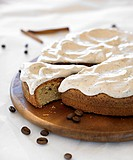Coffee cake with cinnamon cream, a slice cut