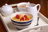 Bowl of cornflakes on breakfast tray