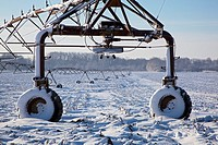 Boggstown, Indiana - Irrigation equipment in a snow-covered farm field in winter