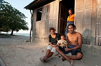 Three generations, Ines Dos Santos,60, her daughter Joanne Gina Diaz, husband Avelino Diaz a farmer and their baby Carno, outside their home in Com, L...