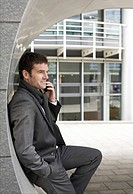 Businessman telephoning with mobile phone, side view