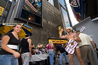 The Naked Cowboy Robert John Burck plays his guitar in Times Square, New York, New York