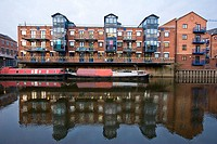 Apartments and houseboats line the river Aire in Leeds West Yorkshire England December 12 2007