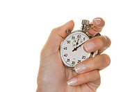 A hand with a stopwatch