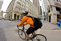 A young man commuting on his bike in Calgary, AB