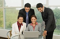 Business executives discussing a project in an office