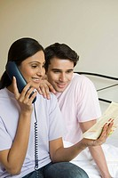 Couple ordering food on the telephone