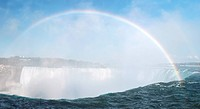 Rainbow over Niagara Falls Horseshoe waterfall. Ontario Canada.