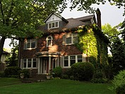 Family house springtime scenery. Baby Point neighbourhood Toronto Ontario Canada