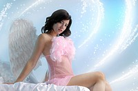 Beautiful young woman with angel wings