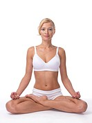 Young woman meditating in Lotus pose