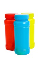 Close_up of colorful plastic jars