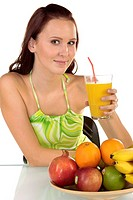 A young, pretty, and healthy drink fruit juice