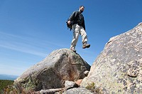 A hiker on Middle Sister Trail near Mount Chocorua during the spring months  Located in the White Mountains, New Hampshire USA
