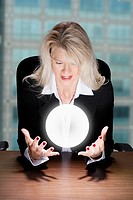 A businesswoman gazes her crystal ball