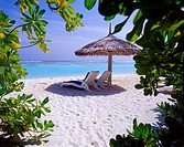 Two chairs on the beach under the umbrella near the ocean  Maldives, Indian ocean