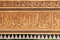 Detail of Kufic style stucco plasterwork lettering at the Ali Ben Youssef Medersa, Marrakech, Morocco, North Africa