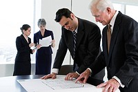 View of businesspeople planning in an office