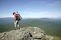 Hiker on Caps Ridge Trail in the White Mountains, New Hampshire USA