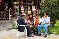 Peruvian customers in discussion with a shopkeeper in Miraflores, Lima, Peru, South America