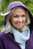 Mature woman wearing a hood
