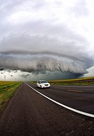 A car flees a supercell west of Greensburg, Kansas.