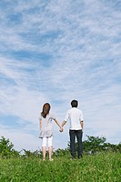 Couple Standing in Park Holding Hands