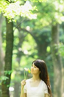 Japanese Girl Holding Flowers