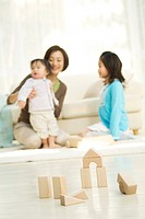 Family in the living room with building blocks