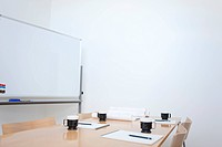Whiteboard and table in empty board room