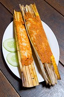 Traditional nyonya fish cakes called otak otak cooked in bamboo