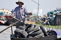 Can Tho (Vietnam): a man selling used tires at the Cat Rang floating market