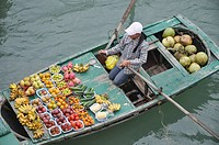 Halong Bay (Vietnam): a fruit seller on her boat