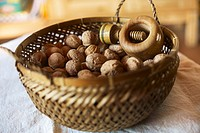 Bowl of mixed walnuts with nutcracker