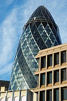 The ´Gherkin´ Swiss Re Tower at 30 St Mary Axe rising above nearby office buildings, City of London, England