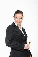 young beautiful businesswoman holding a glass of white wine