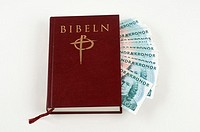 Bible stuffed with money