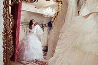Bride trying wedding dress