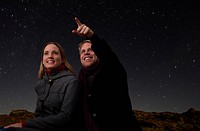couple watching the starry night sky