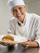 A female chef holding a pastry desert
