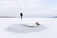 Man on frozen lake