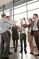 Happy business executives with champagne