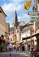 Colourful old decorated half timbered shops and tourist in the main street Ahrweiler Germany Europe