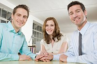 Germany, Munich, three Business people in office, smiling, portrait