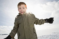 Germany, Bavaria, Munich, Boy 8_9 in snowy landscape, smiling, portrait