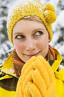 Italy, South Tyrol, Young woman with bobble cap, close up, portrait