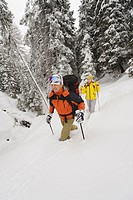 Italy, South Tyrol, Man and woman snowshoeing