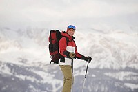 Italy, South Tyrol, Man snowshoeing